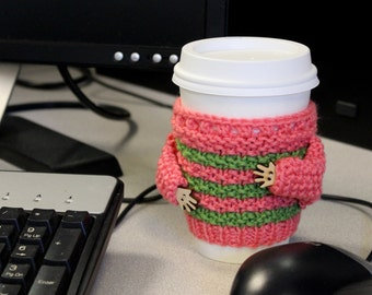 Knitted cup cozy. Whimsical cup sweater. Handknit coffee cozy. Cup sleeve. Gift for coworker.  Coral green. Travel mug sleeve. Cup cuff