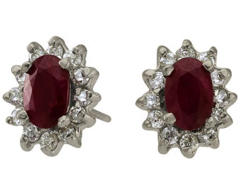 One Ct Tw Oval Rubies Surrounded By Diamonds14Kt White Gold