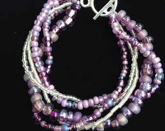 Purple and silver multi strand beaded bracelet