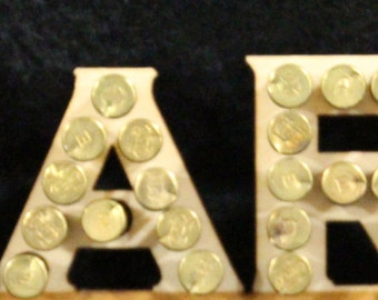 Custom made name bullet plaque with your name in .22 caliber Brass casings.