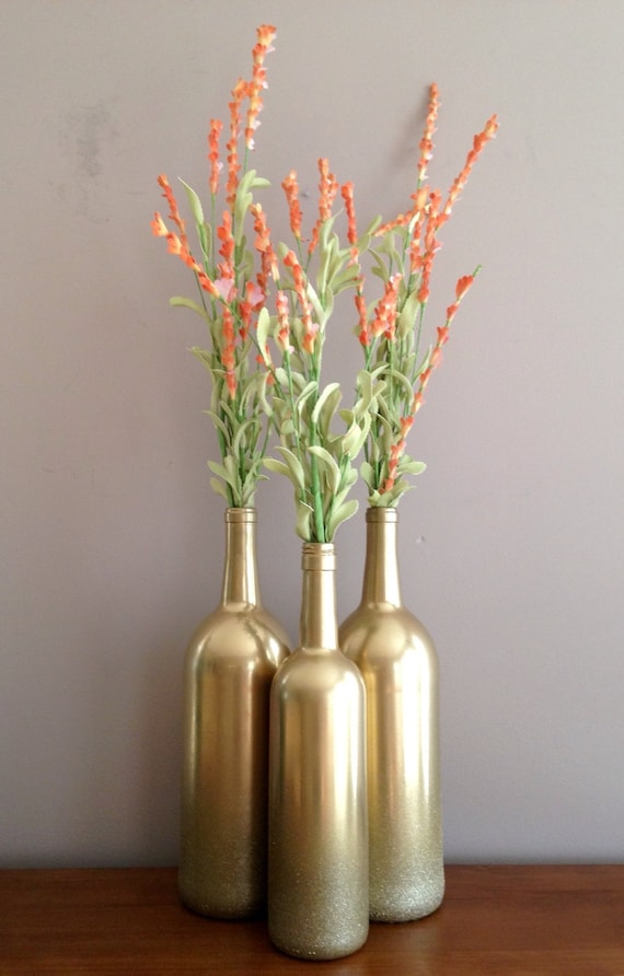 Gold wine bottles gold bottles gold vases gold by for How to make flower vases out of wine bottles