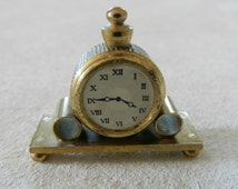 Dolls house miniature mantle piece clock in brass made in France 12th scale