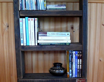 Bookshelf or library on foot of industrial style made of wood and metal recovered