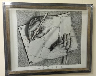 Framed MC ESCHER print. Hands drawing hands