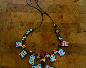 Multi colored fimo necklace PADDLE POP in blue, pink, yellow and brown. Polymer clay and wood beads, learher string, adjustable length. Brig