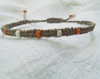 Braided Hemp Bracelet with orange & white beads.