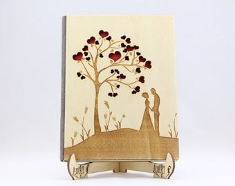 Custom Rustic Wooden Wedding Photo Album with very delicately laser-cut the love tree and newlyweds. Sizes and personalization are possible.