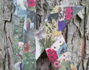 Floral newsprint-collage: The letter K