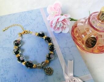 Black rose glass bead bracelet with black rose charm