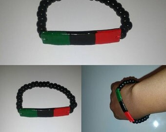 Red black and green! Wear your pride bracelet
