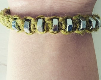 Handmade string plaited bracelet with interwoven hex nuts