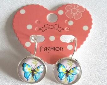 Drop blue butterfly cabochon earrings