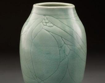 Porcelain vase with etching and celadon glaze