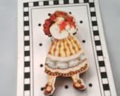 Girl holding heart  wooden buttons