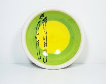 small dish, with two asparagus stalks shown here on a color block of leaf & yellow, made to order.