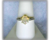 Ethiopian Opal 9x7mm Faceted Gemstone with White Diamond Accents in 10k Yellow Gold Ring Size 9