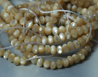 MOP (natural) faceted rondelle 4mm (item ID L08MOPNRN4)