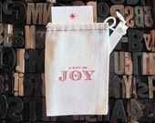"A Gift of JoyLetter Press Bag with mini card • Celebration/Birthday • Cotton Blend Bag • Size3"" x 5"" • Red Ink• Ink Petals"