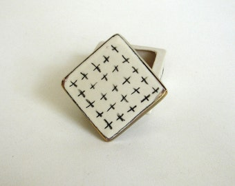 tiny black and white porcelain box with underglaze pencil decoration
