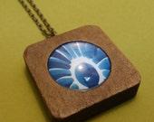 Blue daisy, cyanotype, sun print, negative, shadow, necklace.