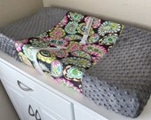Luxuriously soft changing pad cover in charcoal minky and gray, pink, and teal paisley