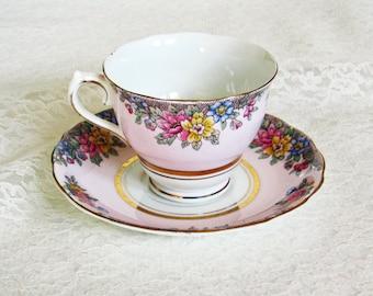 english bone china tea cup and saucer, pink floral bone china, english bone china with gold and floral design