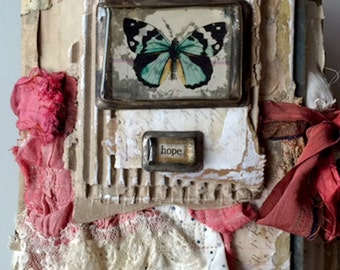 Handmade altered book....wings of hope
