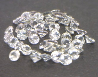 One White Sapphire Accent Gemstone 2.2 mm Well Faceted Round Average .05 carat