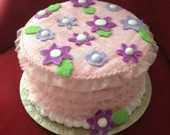 Faux Fake Cake Centerpiece/Gift Box for Girl's Birthday Gift in white and pink with ruffles, purple felt flowers, and pompom trim