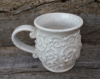 White mug with flourish design