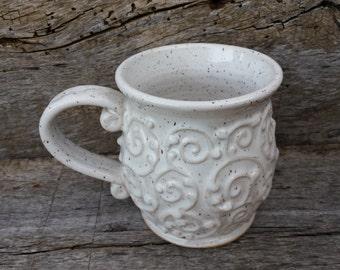 White mug with flourish design