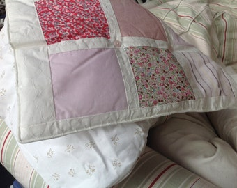 Baby Quilt made with beautiful pink and white fabrics