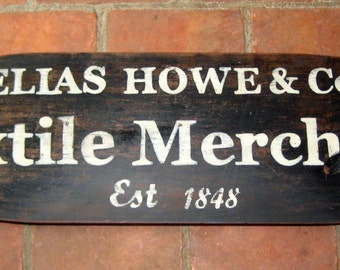 Reproduction Sign on Vintage Oblong Board - Elias Howe, Textile Merchant