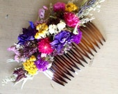 Dried flower hair comb made With an assortment of bright colors. For your wedding or special occasion.