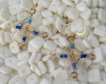 Hand woven 14kt Gold Wire Earrings, Blue Beaded Ojos Earrings