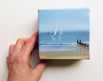original mini oil painting of the beach and sea with sailing boat