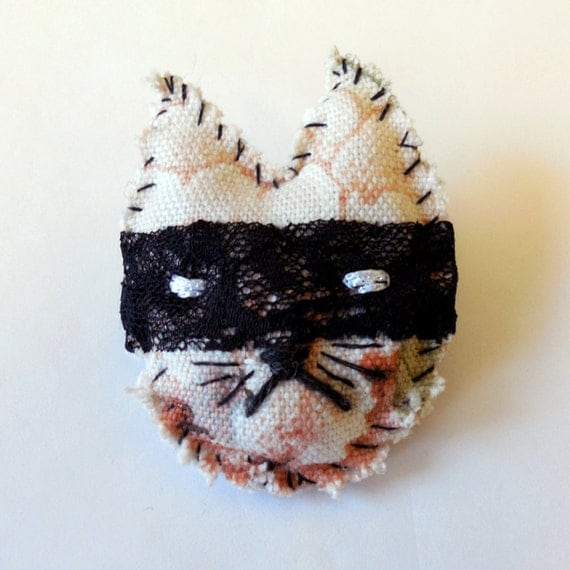 bad cat brooch in floral textile