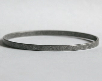 Antiqued Silver plated bangle bracelet for charms.  Flat - 4mm width.  Choose your quantity. For stacking and charms.  Bracelet blank.