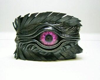 Evil eye,  dragon eye adjustable black handmade leather feather bracelet cuff. Halloween bracelet cuff. Burning man costume. Wicked Fashion
