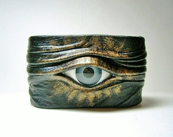 Tool eye adjustable black leather bracelet cuff.