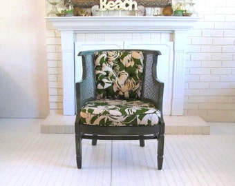 Vintage Chair with tropical print upholstery green frame and cane side panels