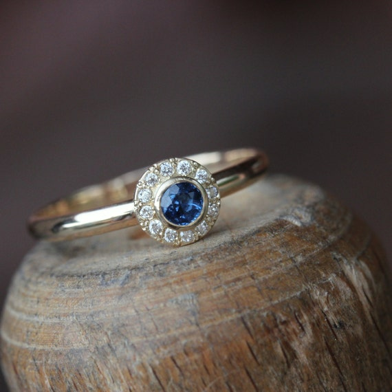 delicate vintage inspired engagement ring blue sapphire