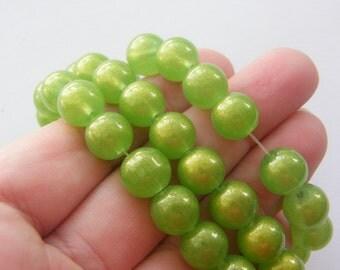 86 Green glitterglass beads B174