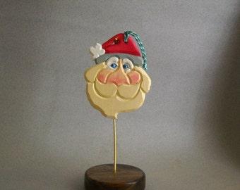 Santa head Christmas ornament