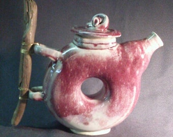 Donut Teapot with wooden handle.