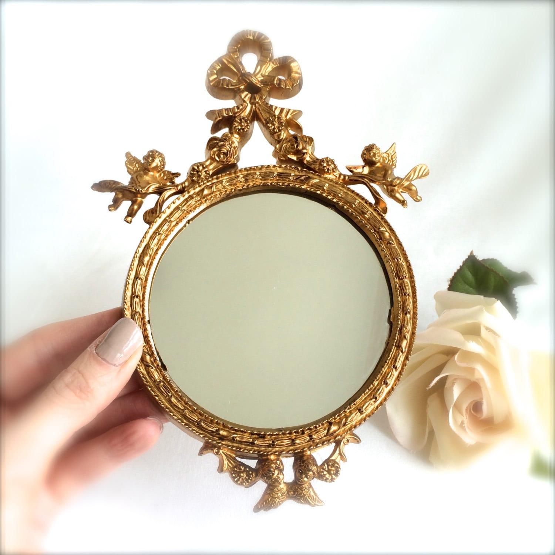 Small gold mirror ornate round miniature mirror bow and cherub for Small gold mirror