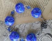 Beautiful Blue Lampwork Beaded Bracelet with Rose Clasp