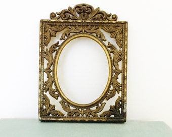 Vintage Italian brass frame small oval patina