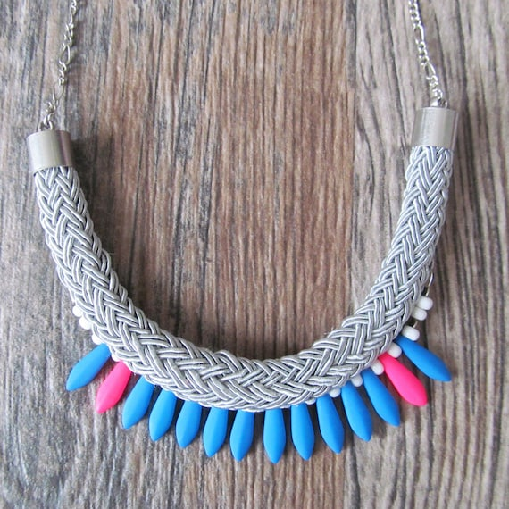 Ajustable necklace on metal chain with blue and neon pink beads and white seed beads on gray braided polyester cord