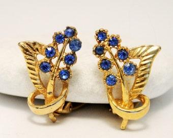 Blue rhinestone earrings. Vintage earrings. Leaf earrings. Clip on earrings.